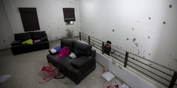 Bullet holes riddle the walls of the second floor of the home that marines raided. Photo / AP
