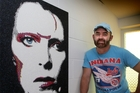 HUNKY DORY: Artist Stanley Manthyng with the David Bowie portrait that will feature in his Icons exhibition in Auckland next month.PHOTO/BEVAN CONLEY