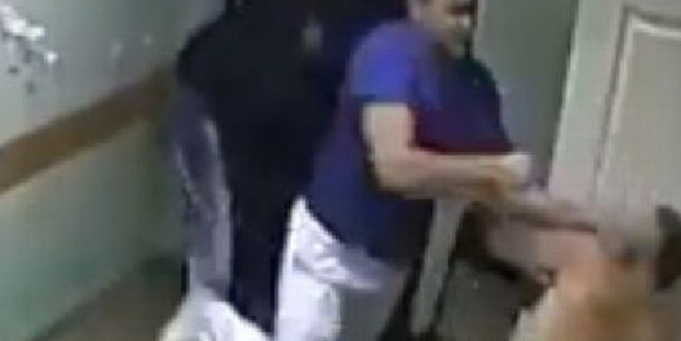 CCTV footgage shows the doctor striking the patient and knocking him to the floor. Photo / YouTube