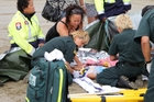 HELP AT HAND: St John paramedics tending to the 4-year-old girl who was thrown from a quad bike on 90 Mile Beach last week,
