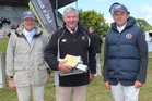 FEI showjumping judge Peter Morris of Masterton, (centre), stepped down from judging at the Central and Southern Hawke's Bay championships at Dannevirke at the weekend. Maurice Beatson of Dannevirke (left), Mr Morris and Simon Wilson of Waipukurau, president of the event, at a presentation on Sunday at the A&P Showgrounds. Photo / Christine McKay