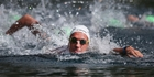 Kane Radford on his way to winning the 5km open water title. Photo / Simon Watts