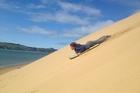 Johnny Cox flies down the Hokianga dunes. Photo / Rob Cox