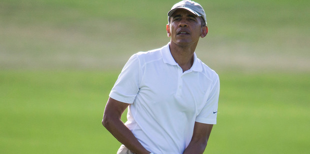 The President is an extremely keen golfer, and has played more than 200 rounds of golf since taking office. Photo / AP