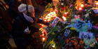 Flowers, candles and photographs are placed in front of the apartment building where David Bowie once lived in Berlin, Germany. AP photo / Kay Nietfeld