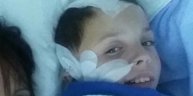 Kade Phillips recovering in hospital after being struck with an electric fence post on his way to school. Photo / Supplied