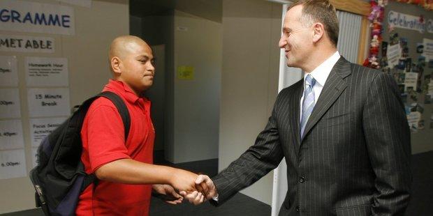 John Key meets Antoni Kalekale in 2007 after the boy egged his car. Photo / Glen Jeffries