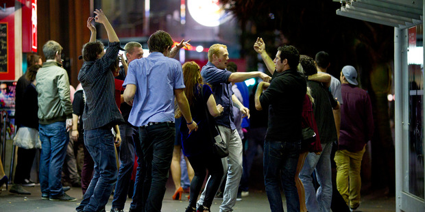 The Kiwi drinking culture in full glory as people party on Auckland city's Queen Street. Photo / Dean Purcell