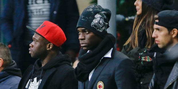 AC Milan's Mario Balotelli watches from the stands at the end of a Serie A match between AC Milan and Bologna. Photo / AP