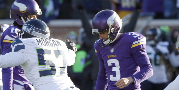 Blair Walsh reacts after missing the game-winning field goal. photo / AP