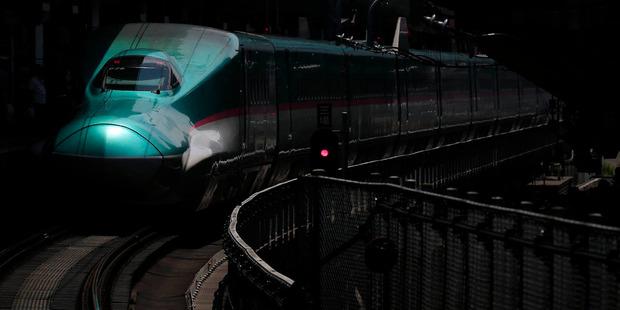 An East Japan Railway E5 series Shinkansen bullet train on the platform at Tokyo Station. Bloomberg / Kiyoshi Ota