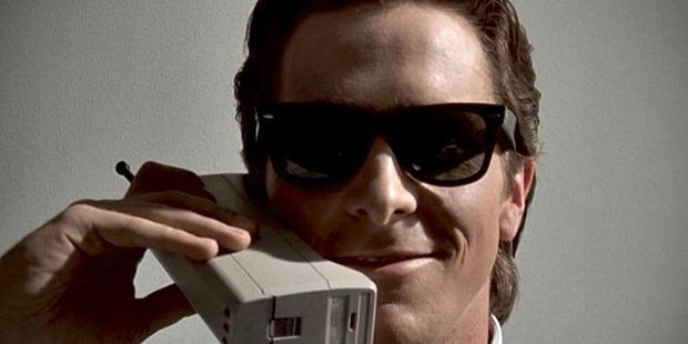 Status symbol: Christian Bale on his Motorola DynaTAC 8000X in American Psycho. Photo / Lions Gate Films.