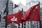 The Chinese and Hong Kong national flags fly near the Hong Kong Stock Exchange in China. Photo / Bloomberg
