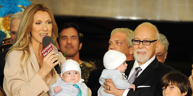 Celine Dion and Rene Angelil with their children in 2011. Photo / Getty