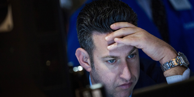 A trader works on the floor of the New York Stock Exchange. Stock markets around the world have suffered since trading began this year. Photo / Getty Images
