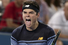 Milos Raonic reacts after winning his men's final match against Roger Federer of Switzerland 6-4, 6-4 during the Brisbane International . Photo / AP