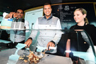 Jo-Wilfried Tsonga mixes his own icecream while David Ferrer signs a jeraboam of champagne. Inset, bottom: Wayne Howett.