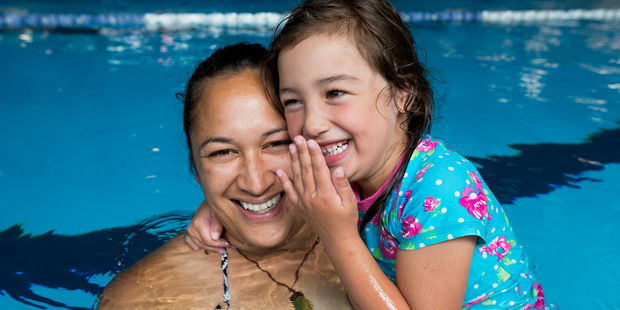 Amelia Jones, 4, is learning to swim with the help of her mother Asia Jones at the Glenfield Pools. Photo / Dean Purcell