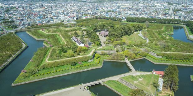 The star-shaped Goryokaku Fort in Hakodate is lined with cherry blossoms in Spring. Photo /123RF