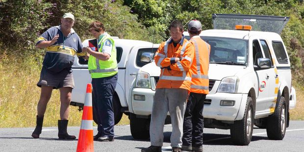 Police and roading staff at the cordon on Oparure Road west of Te Kuiti, where 3 people were killed. Photo / Brett Phibbs