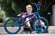 Alex Sutton, 13, with his bike which was stolen and badly damaged when it was hit by a car pursuing the thief. Photo / Jason Oxenham