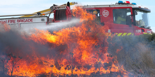 Aussie firefighters attend to a fast moving grass fire in Melbourne, Victoria.