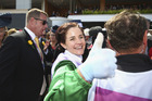 Michelle Payne celebrates after riding Prince of Penzance to The Melbourne Cup. Photo / Getty Images