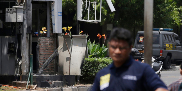 Indonesia police near one of the bomb locations in Jakarta. AP Photo/Achmad Ibrahim