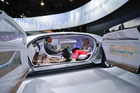 Passengers sit face-to-face in the self-driving Mercedes-Benz F 015 concept car shown off at the International CES in Las Vegas. Photo / AP