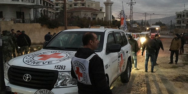 A convoy containing food, medical items, blankets and other materials being delivered to Madaya has been blockaded for months by government troops and the Lebanese militant group Hezbollah. Photo / AP