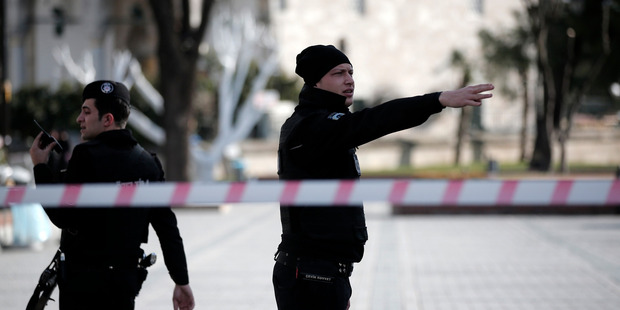 A policeman gestures as he patrols with a colleague at the historic Sultanahmet district after an explosion in Istanbul. Photo / AP