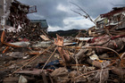 A mannequin sticks out from the rubble in Kesennuma, Miyagi prefecture, after the earthquake and tsunami devastated much of north-eastern Japan on March 11, 2011. Photo / AP