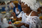 A  woman prepares 'acaraje' at a fair in Rio de Janeiro. New guidelines in Brazil emphasise the social aspects of healthy eating. Photo / AP