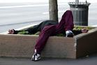 A drunk man sleeps in a street garden. Photo/file