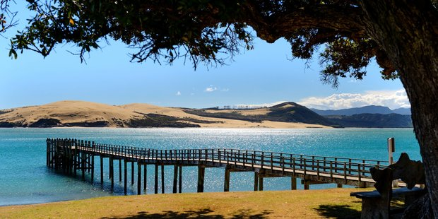 The view over the harbour, sand dunes, and wharf from the Copthorne Hotel Hokianga. Photo / Supplied