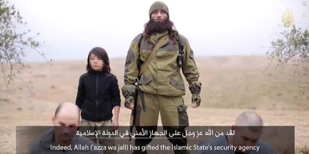A video released by the terror group ISIS shows a young boy coldly executing two men who the terror group claims were Russian spies. Photo / Supplied