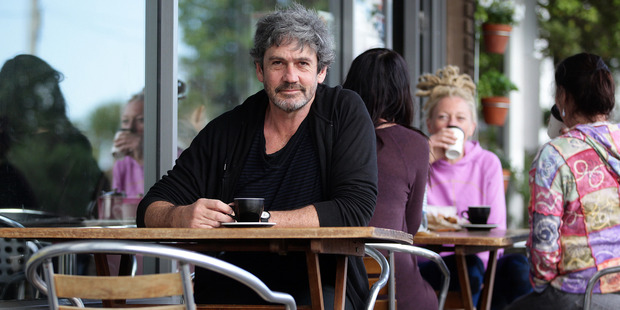 Herald on Sunday columnist Paul Little ponders a move to The Hokianga while drinking coffee in the urban environment of West Lynn Auckland. Photo / Doug Sherring