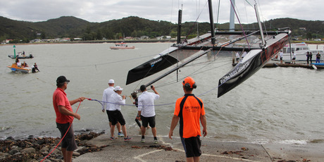 A rapidly dropping tide created some anxious moments as the catamaran was lowered into the water at Waitangi. Photo / Peter de Graaf