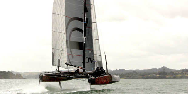 The GC32 on the water in the Bay of Islands for the first time. Once the catamaran hits 16 knots its foils lift it out of the water. PHOTO / HANA HIELKEMA