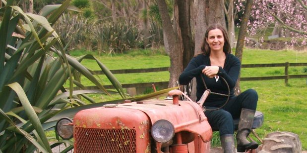 Sophie Siers and her Allis Chalmers tractor, which will make an appearance at the Solway College centenary weekend next month. PHOTO/SUPPLIED