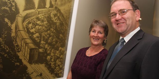 Peter and Jenny Giddens standing next to their feature window at their new South Wairarapa office. PHOTO/ANDREW BONALLACK