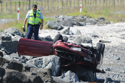 Emergency services are at Awarua Bay after a car has crashed off the road onto rocks, on the Firth of Thames. Photo / SNPA / Ross Setford