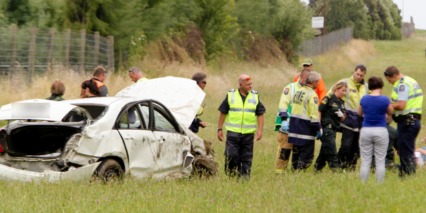 Police and emergency services at the scene of a crash where a car rolled on the Expressway near Hastings. Photo / Warren Buckland