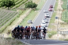 Support vehicles line up behind the elite men's road race as riders race up Appley Rd,  west of Napier. Photo / Paul Taylor