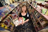 POPULAR: Team leader for children and teenage services Michelle Anderson with the city's most popular library books.PHOTO/GEORGE NOVAK