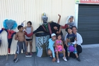 EXCITEMENT: A group of Wairoa children pose with one of the scarecrows entered in this year's new competition.PHOTO/SUPPLIED