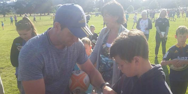 Ben Smith signs an autograph for a young fan following his training session in Wanaka. Photo - Facebook/Joanne White