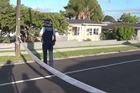 Armed police swarmed to an Auckland suburb tonight after a body was found in unexplained circumstances.