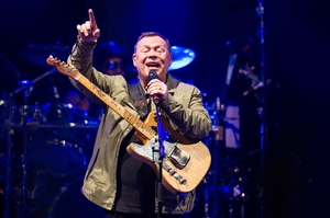 UB40's Ali Campbell, right, gets the crowd into the reggae vibe. Photo / Stephen Parker