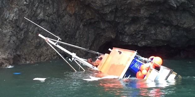 The boat was found north of Whale Bay on rocks and was 90 per cent submerged, Coastguard said. Photo / Coastguard Bay of Islands